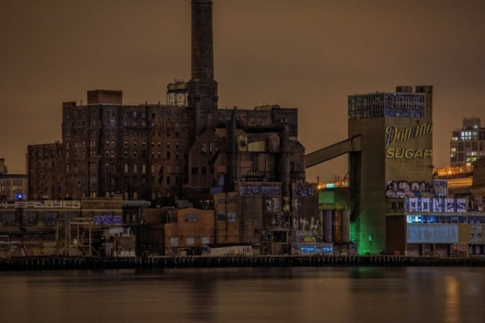 A distant shot of the abandoned Domino Sugar Factory at Brooklyn in New York