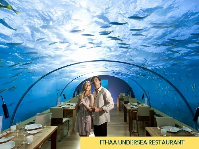 A couple at the undersea Ithaa diner in Maldives