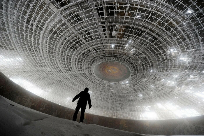 A person looks at the ceiling of the House of the Bulgarian Communist Party in Belgium