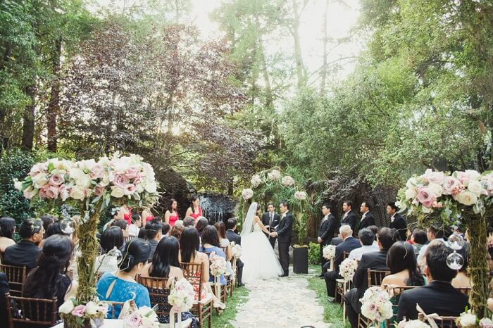 A couple exchanging vows at Calamigos Ranch in Malibu