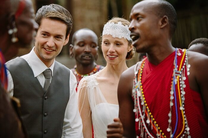 A couple interacts with the locals after the marriage at Mara Bushtops in Kenya