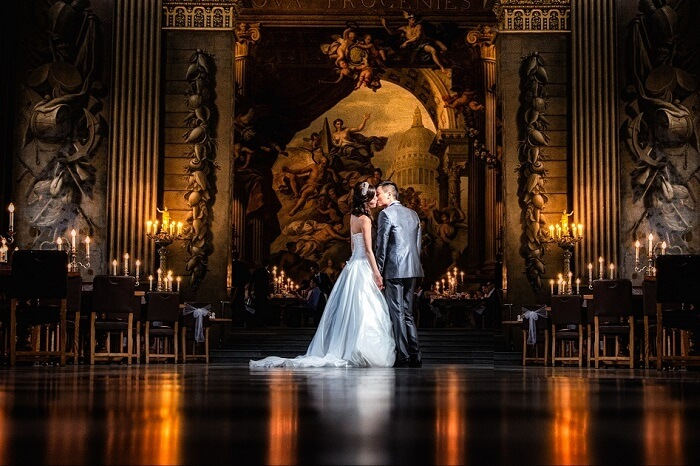 A couple kisses at the Painted Hall at the Old Royal Naval College during a wedding shoot in London