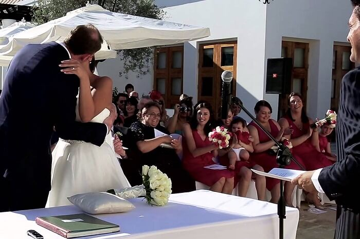 A couple kissing after exchanging wows at Hotel Anassa in Cyprus