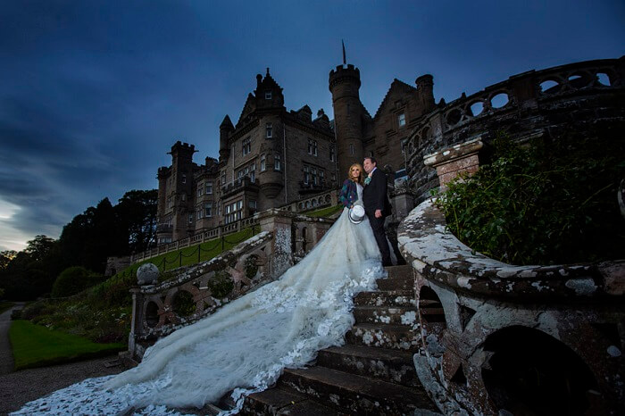 A couple poses for the wedding shoot at Skibo Palace in London