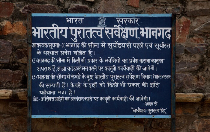 An ASI hoarding at Bhangarh fort - one of the most haunted places in India