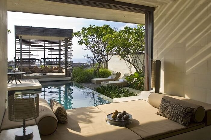 bedroom with stunning views of alila villas architecture