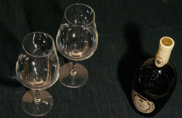 two glasses and bottle of red wine