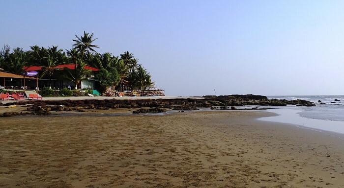 Boat shacks and restaurants along the Ashwem Beach