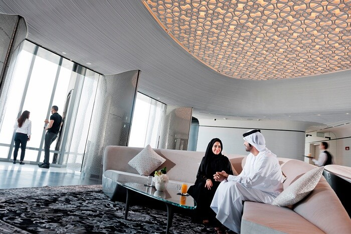Guests relax and interact at the At The Top Sky Lounge on level 148 of Burj Khalifa