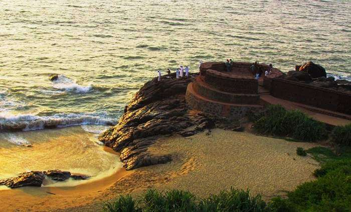 The stunning Bekal Fort with the background of colorful sunset at Bekal in Kerala