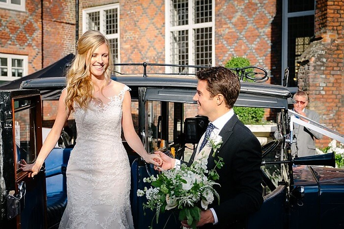 Bride and her best man at a wedding arrive at Fulham Palace