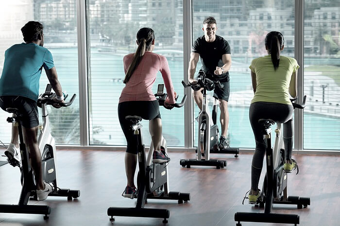 A gym trainer instructing the guests at the Burj Club Gym