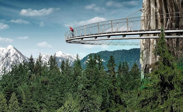 A guy enjoying the view from Capilano Suspension Bridge in Vancouver
