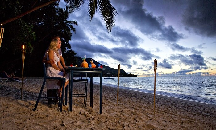 A couple having a quiet dinner in Seychelles