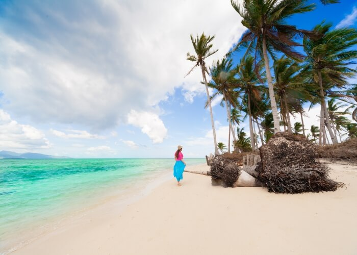 Woman strolling at a beach in Fiji