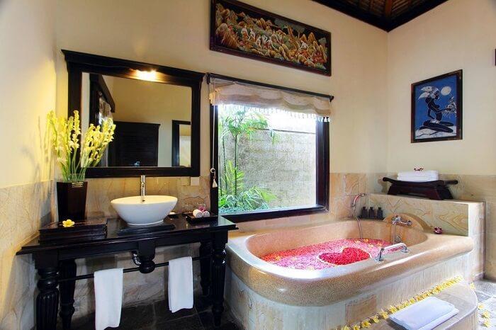 honeymoon suite's bathroom with bathtub in Furama Villas