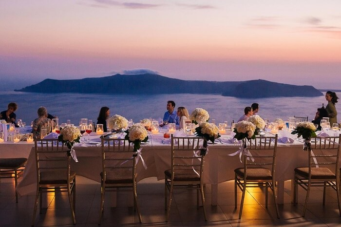 Guests at the wedding dinner at La Maltese Estate of Santorini in Greece