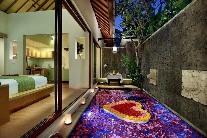 honeymoon suite with flower arrangement in ini vie villa