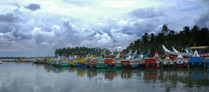 Several colorful boats stationed at Kozhikode Lake