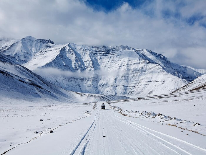 Snow clad mountains and the roads on way to Chadar trek