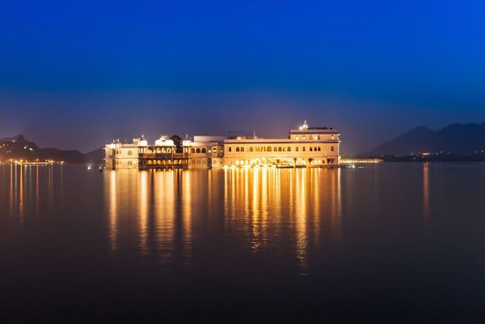 An illuminated Lake Palace is a popular tourist attraction in Rajasthan