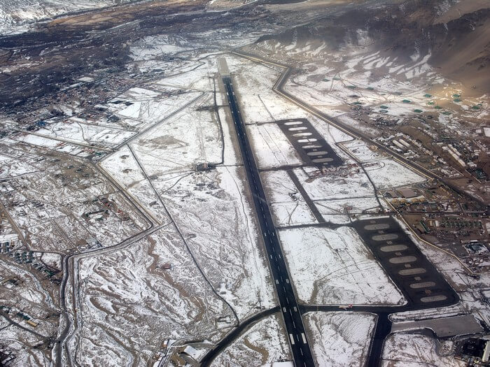 An aerial view of the snow covered Leh airport