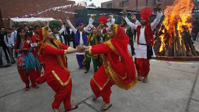 Men and women dancing during Lohri celebrations - the liveliest among winter festivals of India