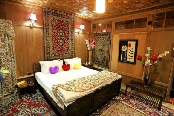 The palatial decor of Mughal Palace Houseboats make them popular choice for hotels in Srinagar near Dal Lake