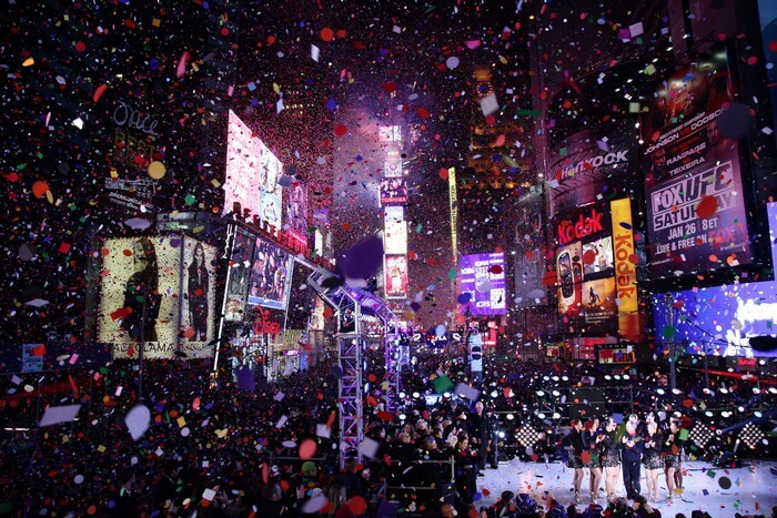 Confetti at Times Square soaks in the revellers during New Year Celebrations in New York