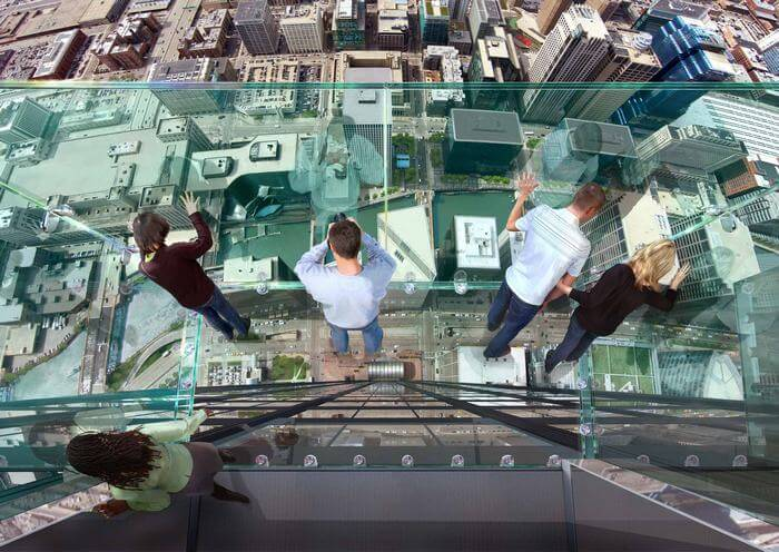 People looking out from Observation Deck at Willis Tower in Chicago