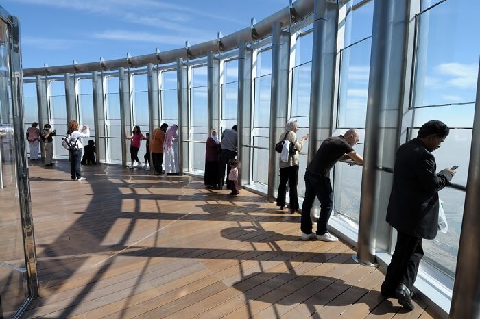 Tourists looking out from the observation deck at Burj Khalifa