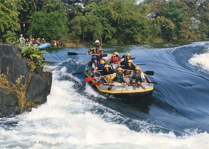 Tourists enjoy rafting in the white waters at Dandeli