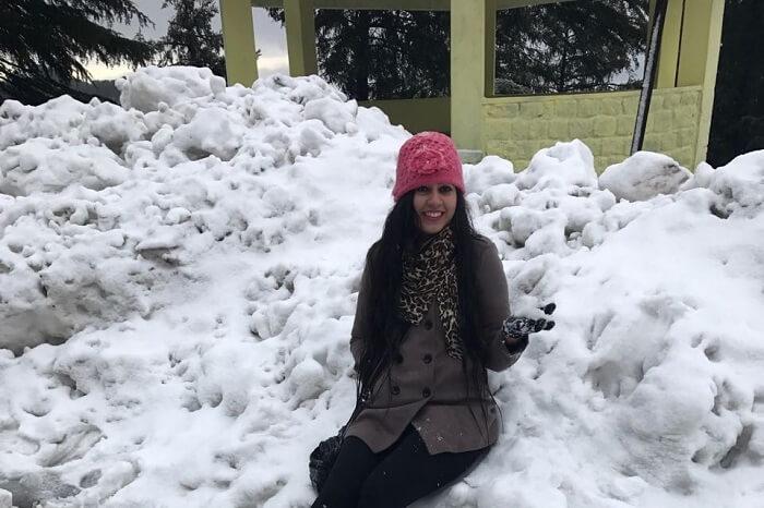 Girl enjoying snowfall in Dalhousie
