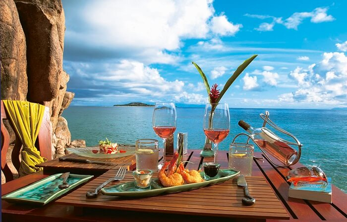 A romantic setting for two to enjoy the Seychellois food on their honeymoon to Seychelles