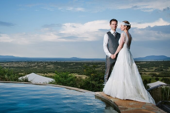 The bride and the groom pose after the marriage at Mara Bushtops in Kenya