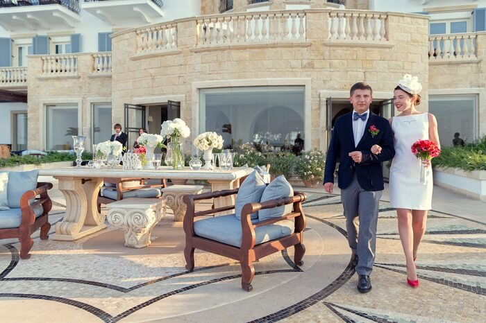 The bride arrives with her Best Man for the wedding at Anassa in Cyprus