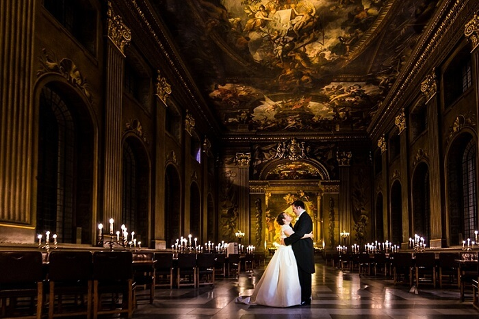 A couple pose at the Painted Hall at the Old Royal Naval College for a wedding shoot