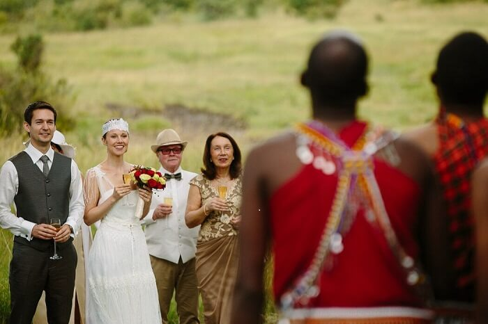 The wedded couple along with their family interact with the locals at Mara Bushtops