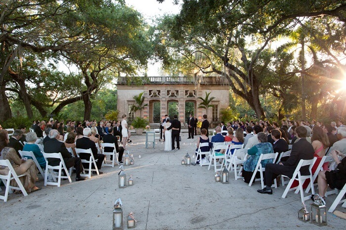 The wedding ceremony going on at Vizcaya museum and gardens in USA
