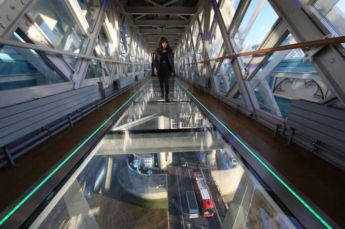 Girl walking over the Tower Bridge walkway in UK