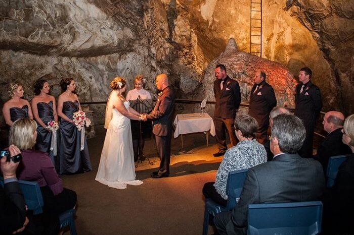 Vows being exchanged during a wedding ceremony at Jenolan Caves in Australia