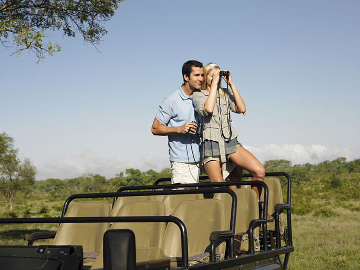 A couple enjoying a Jeep Safari ride at the Kalakkadu Wildlife Sanctuary