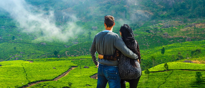 A couple enjoying the stunning green scapes of Munnar