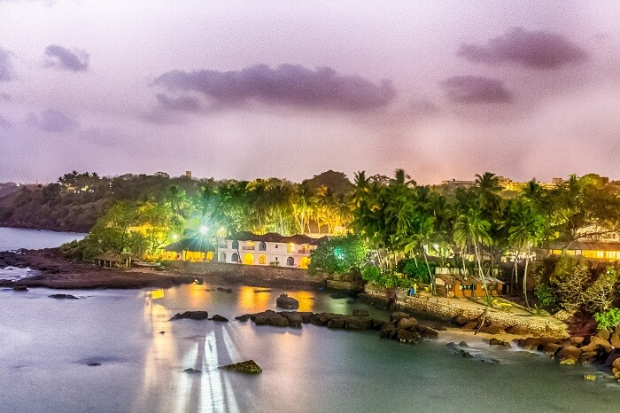 A sunset view of a bungalow at the Dona Paula Beach in Goa