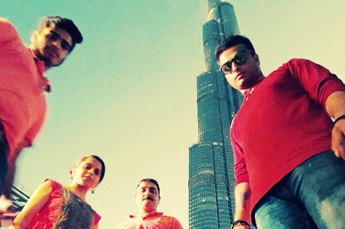 me and my family standing below burj khalifa