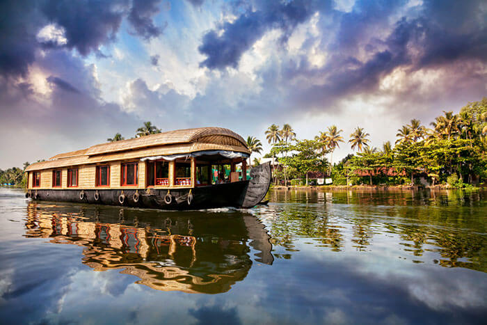 A houseboat sailing on the backwaters of Alleppey