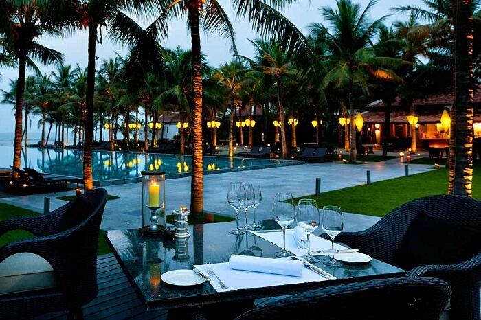 A poolside restaurant at the Nam Hai Four Seasons Resort in Hoi An