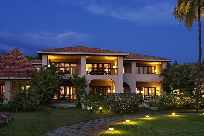 A night shot of the lawn and hotel building at Leela Goa in Cavelossim