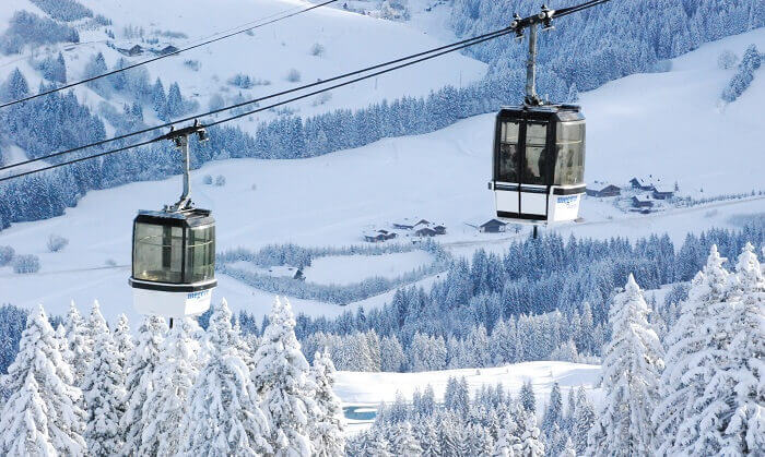 People travel in cable cars at the Megeve Ski Resort