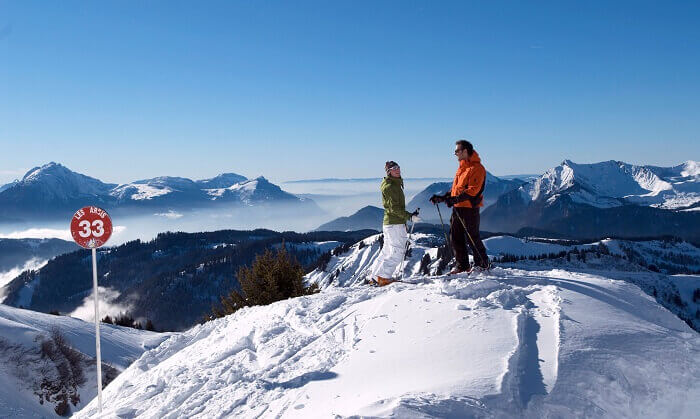 Two skiers take stance at the top of a slope at Morzine ski resort